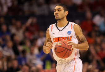 PHOENIX, AZ - MARCH 24:  Peyton Siva #3 of the Louisville Cardinals moves the ball in the first half while taking on the Florida Gators during the 2012 NCAA Men's Basketball West Regional Final at US Airways Center on March 24, 2012 in Phoenix, Arizona.