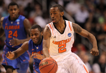 PHOENIX, AZ - MARCH 24:  Russ Smith #2 of the Louisville Cardinals moves the ball against Erving Walker #11 of the Florida Gators in the first half during the 2012 NCAA Men's Basketball West Regional Final at US Airways Center on March 24, 2012 in Phoenix