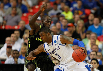 ATLANTA, GA - MARCH 25:  Terrence Jones #3 of the Kentucky Wildcats drives against Quincy Acy #4 of the Baylor Bears during the 2012 NCAA Men's Basketball South Regional Final at the Georgia Dome on March 25, 2012 in Atlanta, Georgia.  (Photo by Streeter
