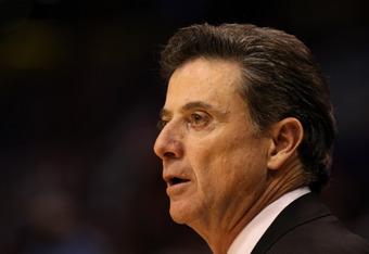 PHOENIX, AZ - MARCH 24:  Head coach Rick Pitino of the Louisville Cardinals looks on in the first half while taking on the Florida Gators during the 2012 NCAA Men's Basketball West Regional Final at US Airways Center on March 24, 2012 in Phoenix, Arizona.