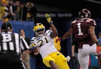 NEW ORLEANS, LA - JANUARY 03:  Junior Hemingway #21 of the Michigan Wolverinescores a 18-yard touchdown reception in the third quarter against Antone Exum #1 of the Virginia Tech Hokies during the Allstate Sugar Bowl at Mercedes-Benz Superdome on January