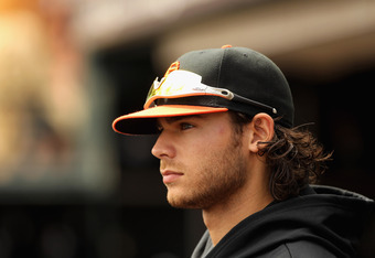 SAN FRANCISCO, CA - SEPTEMBER 04:  Brandon Crawford #35 of the San Francisco Giants stands in the dugout during their game against the Arizona Diamondbacks at AT&T Park on September 4, 2011 in San Francisco, California.  (Photo by Ezra Shaw/Getty Images)