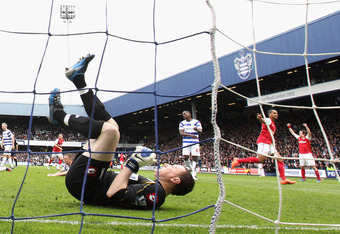 LONDON, ENGLAND - MARCH 31:  Theo Walcott of Arsenal celebrates scoring his side's equalising goal past Paddy Kenny of Queens Park Rangers during the Barclays Premier League match between Queens Park Rangers and Arsenal at Loftus Road on March 31, 2012 in