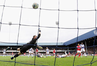 LONDON, ENGLAND - MARCH 31:  Theo Walcott of Arsenal scores his side's equalising goal past Paddy Kenny of Queens Park Rangers during the Barclays Premier League match between Queens Park Rangers and Arsenal at Loftus Road on March 31, 2012 in London, Eng