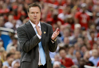 NEW ORLEANS, LA - MARCH 31:  Head coach Bill Self of the Kansas Jayhawks claps as the Jayhawks were on their way to defeating the Ohio State Buckeyes in the National Semifinal game of the 2012 NCAA Division I Men's Basketball Championship at the Mercedes-