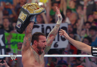 CM Punk successfully retains his WWE Championship.
