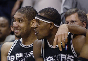 LOS ANGELES - MAY 15:  Tim Duncan #21 and Stephen Jackson #3 of the San Antonio Spurs celebrate the win over the Los Angeles Lakers in Game six of the Western Conference Semifinals during the 2003 NBA Playoffs at Staples Center on May 15, 2003 in Los Ange