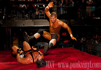 """Resistance Pro Heavyweight Champion Harry Smith drops the leg on Rhino at Obsession, March 23, 2012. Photo by Mike """"MXV"""" Vinikour."""