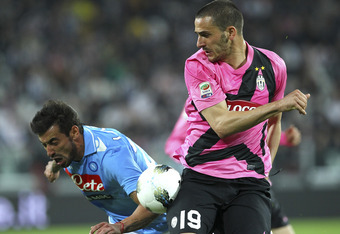 TURIN, ITALY - APRIL 01:  Ezequiel Lavezzi (L) of SSC Napoli competes for the ball with Leonardo Bonucci of Juventus FC during the Serie A match between Juventus FC and SSC Napoli at Juventus Arena on April 1, 2012 in Turin, Italy.  (Photo by Marco Luzzan