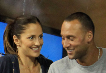 NEW YORK - SEPTEMBER 04:  Actress Minka Kelly and Derek Jeter of the New York Yanklees watch as Novak Djokovic of Serbia plays against James Blake of the United States during his men's singles match on day six of the 2010 U.S. Open at the USTA Billie Jean