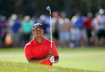 ORLANDO, FL - MARCH 25:  Tiger Woods plays a shot on the 10th hole during the final round of the Arnold Palmer Invitational presented by MasterCard at the Bay Hill Club and Lodge on March 25, 2012 in Orlando, Florida.  (Photo by Sam Greenwood/Getty Images