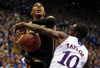 LAWRENCE, KS - FEBRUARY 25:  Phil Pressey #1 of the Missouri Tigers is fouled by Tyshawn Taylor #10 of the Kansas Jayhawks during the game on February 25, 2012 at Allen Fieldhouse in Lawrence, Kansas.  (Photo by Jamie Squire/Getty Images)