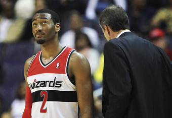 WASHINGTON, DC - FEBRUARY 29: John Wall #2 of the Washington Wizards looks up at the video board while standing next to head coach Randy Wittman during the second half against the Orlando Magic at the Verizon Center on February 29, 2012 in Washington, DC.
