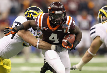 NEW ORLEANS, LA - JANUARY 03:  David Wilson #4 of the Virginia Tech Hokies runs the ball against the Michigan Wolverines during the Allstate Sugar Bowl at Mercedes-Benz Superdome on January 3, 2012 in New Orleans, Louisiana.  (Photo by Matthew Stockman/Ge
