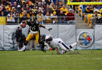 20 Jan 2002 : Kordell Stewart #10 of the Pittsburgh Steelers narrowly escapes the defense of Sam Adams #95 of the Baltimore Ravens during the AFC divisional playoff game at Heinz Field in Pittsburgh, Pennsylvania. The Steelers won 27-10. DIGITAL IMAGE. Ma