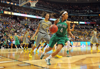 DENVER, CO - APRIL 03:  Skylar Diggins #4 of the Notre Dame Fighting Irish controls her dribble in the second half against Brittney Griner #42 of the Baylor Bears during the National Final game of the 2012 NCAA Division I Women's Basketball Championship a