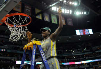 DENVER, CO - APRIL 03:  Destiny Williams #10 of the Baylor Bears celebrates as she cuts down a piece of the net after they won 80-61 against the Notre Dame Fighting Irish during the National Final game of the 2012 NCAA Division I Women's Basketball Champi