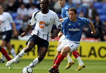 Fabrice Muamba in white shirt