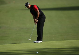 Woods rolls in a put at last year's Chevron World Challenge, which he eventually won after birdieing the last two holes.