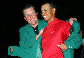 Woods slips on his fourth green jacket in 2005. He and Arnold Palmer are second to only Jack Nicklaus in Masters victories.