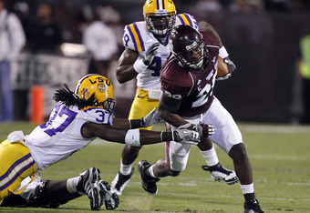 STARKVILLE, MS - SEPTEMBER 15:  Running back Vick Ballard #28 of the Mississippi State Bulldogs tries to get around linebacker Karnell Hatcher #37 of the LSU Tigers on September 15, 2011 at Davis Wade Stadium in Starkville, Mississippi. (Photo by Butch Di