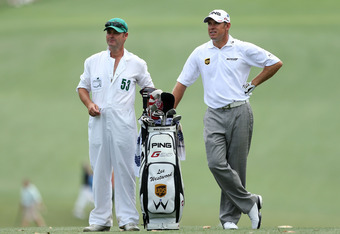 AUGUSTA, GA - APRIL 05:  Lee Westwood of England and his caddie Billy Foster stand on the fairway during the first round of the 2012 Masters Tournament at Augusta National Golf Club on April 5, 2012 in Augusta, Georgia.  (Photo by Andrew Redington/Getty I