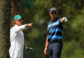 AUGUSTA, GA - APRIL 05:  Henrik Stenson of Sweden and his caddie Oliver O'Reilly look at a shot from the rough on the 15th hole during the first round of the 2012 Masters Tournament at Augusta National Golf Club on April 5, 2012 in Augusta, Georgia.  (Pho