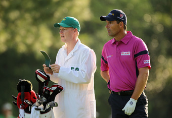AUGUSTA, GA - APRIL 05:  Padraig Harrington of Ireland (R) waits alongside caddie Ronan Flood (L) on the first hole during the first round of the 2012 Masters Tournament at Augusta National Golf Club on April 5, 2012 in Augusta, Georgia.  (Photo by Jamie