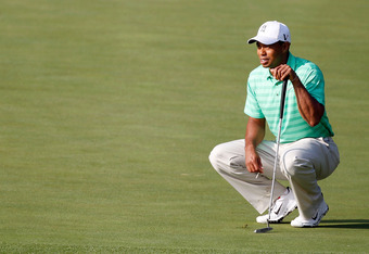 AUGUSTA, GA - APRIL 04:  Tiger Woods lines up a putt during a practice round prior to the start of the 2012 Masters Tournament at Augusta National Golf Club on April 4, 2012 in Augusta, Georgia.  (Photo by Streeter Lecka/Getty Images)