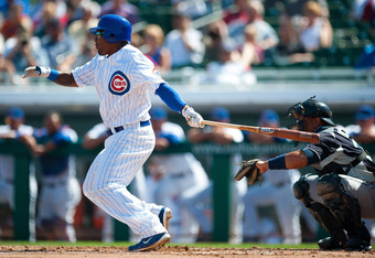 MESA, AZ - MARCH 8: Marlon Byrd #24 of the Chicago Cubs bats during the game against the Seattle Mariners at HoHoKam Stadium on March 8, 2012 in Mesa, Arizona. (Photo by Rob Tringali/Getty Images)
