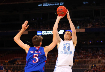 ST LOUIS, MO - MARCH 25:  Tyler Zeller #44 of the North Carolina Tar Heels attempts a shot in the first half against Jeff Withey #5 of the Kansas Jayhawks during the 2012 NCAA Men's Basketball Midwest Regional Final at Edward Jones Dome on March 25, 2012