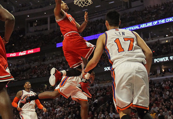 CHICAGO, IL - MARCH 12:  Derrick Rose #1 of the Chicago Bulls puts up a shot over Jeremy Lin #17 of the New York Knicks at the United Center on March 12, 2012 in Chicago, Illinois. The Bulls defeated the Knicks 104-99. NOTE TO USER: User expressly acknowl