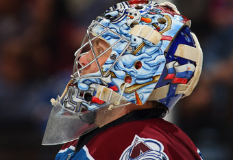 DENVER, CO - MARCH 20:  Goalie Semyon Varlamov #1 of the Colorado Avalanche looks on during a break in the action as he had 31 saves against the Calgary Flames at Pepsi Center on March 20, 2012 in Denver, Colorado. The Avalanche defeated the Flames 2-1 in