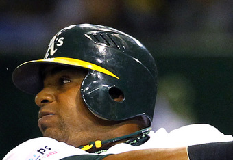 TOKYO, JAPAN - MARCH 29: Yoenis Cespedes #52 of the Oakland Athletics hits a two run home run during the seventh inning of a MLB game against the Seattle Mariners at Tokyo Dome on March 29, 2012 in Tokyo, Japan. (Photo by Koji Watanabe/Getty Images)