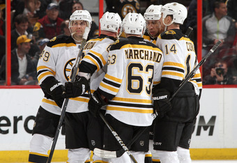 OTTAWA, CANADA - APRIL 5: Greg Zanon #6 of the Boston Bruins celebrates his second period goal with teammates Rich Peverley #49, Brad Marchand #63, Chris Kelly #23 and Joe Corvo #14 during an NHL game against the Ottawa Senators at Scotiabank Place on Apr