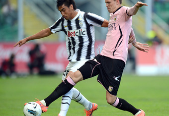 PALERMO, ITALY - APRIL 07:  Josip Ilicic (R) of Palermo and Marcelo Estigarribia of Juventus compete for the ball during the Serie A match between US Citta di Palermo and Juventus FC at Stadio Renzo Barbera on April 7, 2012 in Palermo, Italy.  (Photo by T