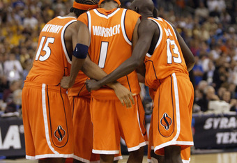 NEW ORLEANS - APRIL 7:  Carmelo Anthony #15, Hakim Warrick #1, Kueth Duany #13 and two teammates all of Syracuse huddle on the floor against Kansas during the championship game of the NCAA Men's Final Four Tournament on April 7, 2003 at the Louisiana Supe