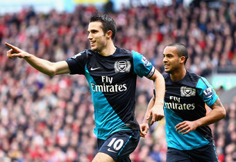 LIVERPOOL, ENGLAND - MARCH 03:  Robin van Persie of Arsenal celebrates scoring the equalising goal with teaammate Theo Walcott (R) during the Barclays Premier League match between Liverpool and Arsenal at Anfield on March 3, 2012 in Liverpool, England.  (