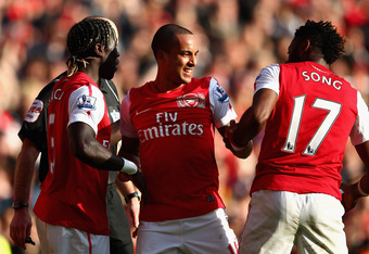 LONDON, ENGLAND - FEBRUARY 26:  Theo Walcott (C) of Arsenal celebrates his second goal with team mates during the Barclays Premier League match between Arsenal and Tottenham Hotspur at Emirates Stadium on February 26, 2012 in London, England.  (Photo by C