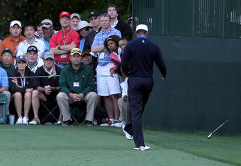AUGUSTA, GA - APRIL 06:  Tiger Woods of the United States kicks his club after a tee shot on 16th hole during the second round of the 2012 Masters Tournament at Augusta National Golf Club on April 6, 2012 in Augusta, Georgia.  (Photo by Jamie Squire/Getty