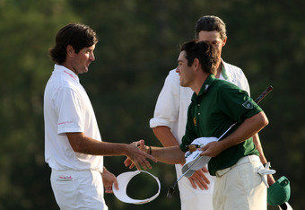 AUGUSTA, GA - APRIL 08:  Bubba Watson of the United States (L) and Louis Oosthuizen of South Africa (R) shake hands on the 18th hole after each making par to force a playoff during the final round of the 2012 Masters Tournament at Augusta National Golf Cl