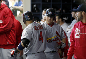 MILWAUKEE, WI - APRIL 06: Matt Holliday #7 of the St Louis Cardinals celebrates in the dugout after hitting a solo home run off of Milwaukee Brewers starter Yovanni Gallardo #49 in the top of the third inning during Opening Day at Miller Park on April 06,