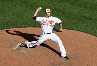 BALTIMORE, MD - APRIL 06:  Starting pitcher Jake Arrieta #34 of the Baltimore Orioles delivers to a Minnesota Twins batter during  opening day at Oriole Park at Camden Yards on April 6, 2012 in Baltimore, Maryland.  (Photo by Rob Carr/Getty Images)