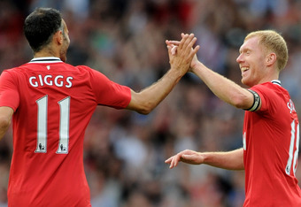 MANCHESTER, ENGLAND - AUGUST 05:  Paul Scholes of Manchester United celebrates scoring the opening goal with team mate Ryan Giggs (L) during his Testimonial Match between Manchester United and New York Cosmos at Old Trafford on August 5, 2011 in Mancheste