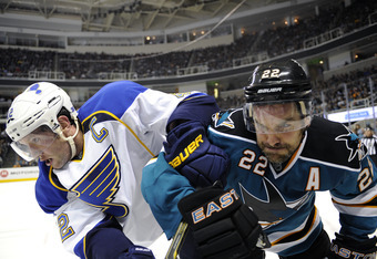 SAN JOSE, CA - OCTOBER 15: David Backes #42 of the St. Louis Blues fights for control of the puck with Dan Boyle #22 of the San Jose Sharks in the third period of an NHL hockey game at HP Pavilion at San Jose on October 15, 2011 in San Jose, California.