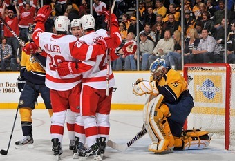 NASHVILLE, TN - MARCH 10:  Drew Miller #20 and Brendan Smith #2 of the Detroit Red Wings celebrate scoring a goal against Pekka Rinne #35 of the Nashville Predators at Bridgestone Arena on March 10, 2012 in Nashville, Tennessee.  (Photo by Frederick Breed