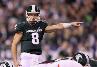 INDIANAPOLIS, IN - DECEMBER 03:  Quarterback Kirk Cousins #8 of the Michigan State Spartans directs the offense against the Wisconsin Badgers during the Big 10 Conference Championship Game at Lucas Oil Stadium on December 3, 2011 in Indianapolis, Indiana.