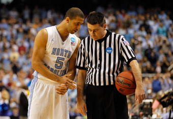 GREENSBORO, NC - MARCH 18:  Kendall Marshall #5 of the North Carolina Tar Heels talks with a referee after a technical foul was called on John Henson #31 of the Tar Heels in the first half against the Creighton Bluejays during the third round of the 2012