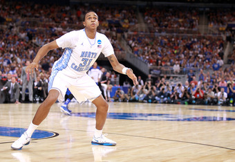 ST LOUIS, MO - MARCH 25:  John Henson #31 of the North Carolina Tar Heels gets in position for a rebound against the Kansas Jayhawks during the 2012 NCAA Men's Basketball Midwest Regional Final at Edward Jones Dome on March 25, 2012 in St Louis, Missouri.