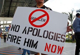 MIAMI, FL - APRIL 10:  Protesters rally outside a press conference held by Miami Marlins Manager Ozzie Guillen for comments made about Fidel Castro at Marlins Park on April 10, 2012 in Miami, Florida. The Marlins suspended Guillen for five games over his